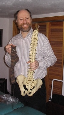 chiropractor-smiling-vertebrae-spine-interview
