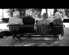 senior-couples-sitting-on-park-bench-peacefully