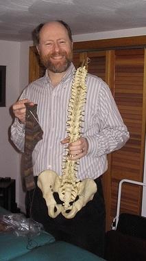 chiropractor-smiling-vertebrae-spine-interview
