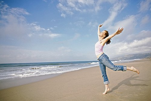 young-woman-beach-waves-dancing-joy-healthy-supple-flexible