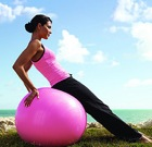yoga-woman-reclines-on-large-exercise-ball